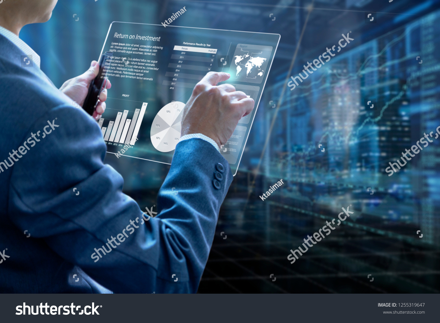 Businessman holding a modern tablet touch screen analysing on investment risk management and return on investment analysis or business performance. #1255319647