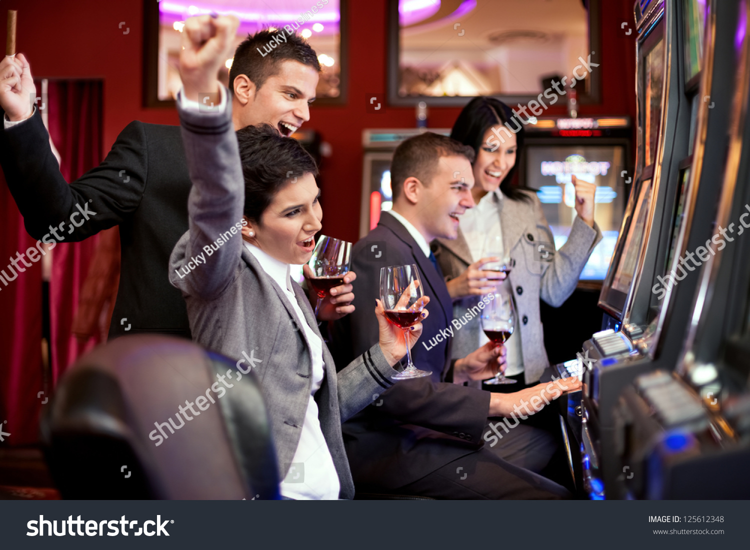 Happiness people winning in the casino on slot machines
