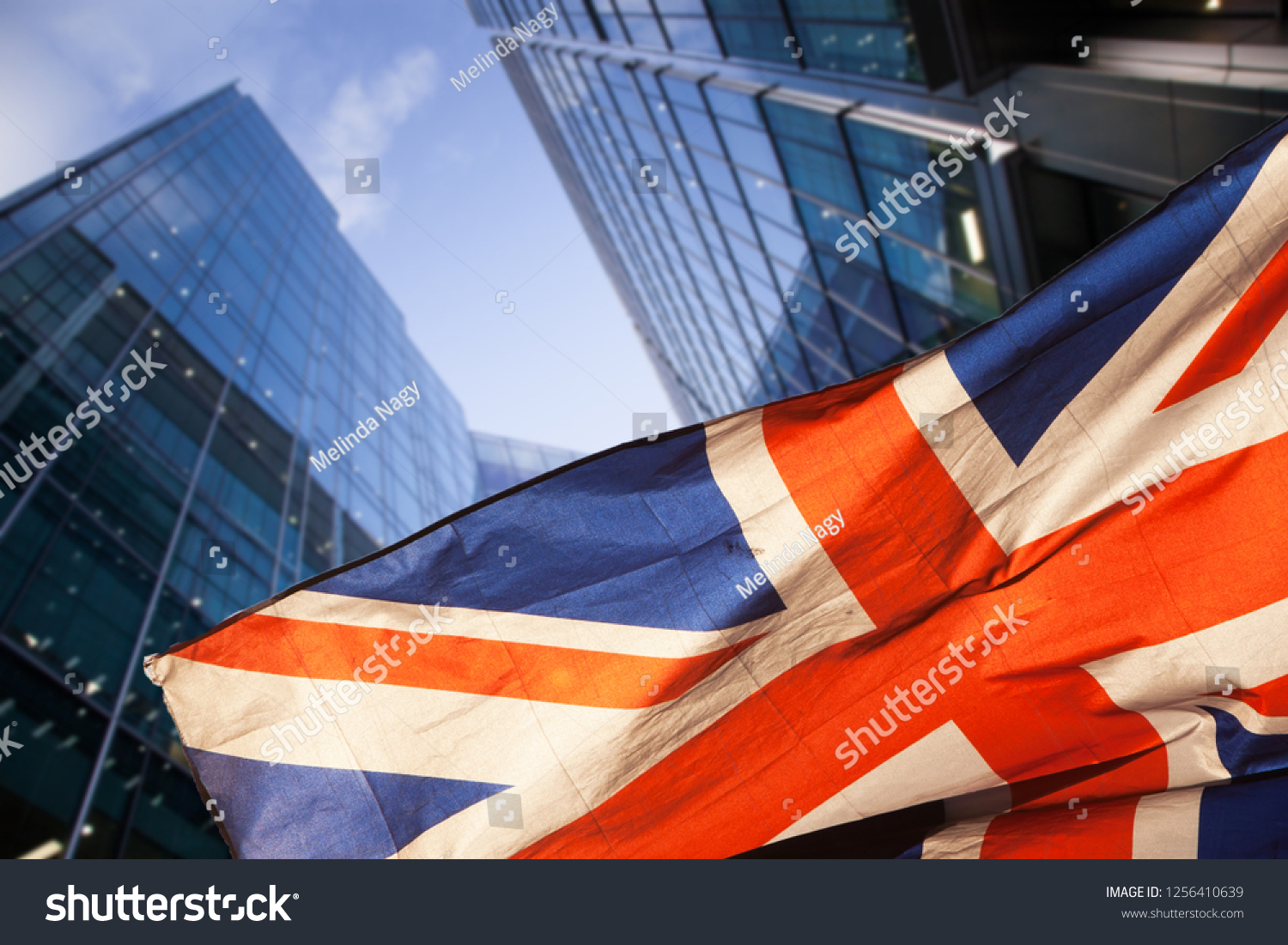 brexit concept - UK economy after Brexit deal - double exposure of flag and Canary Wharf business center skyscrapers #1256410639