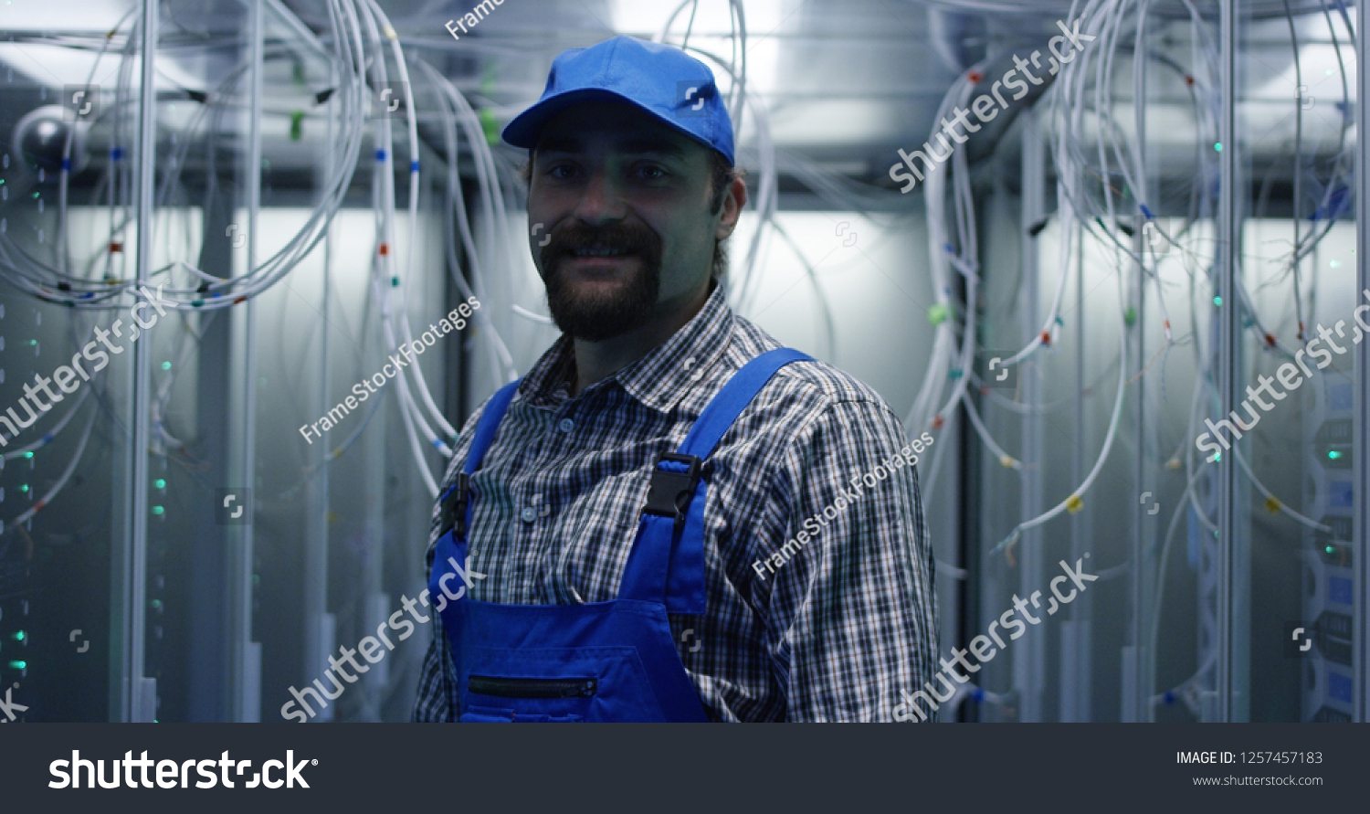 Medium Shot Technician Searching Through Cables Stock Photo Edit Workers Making Wiring Loom Photos Royalty Free Of A At Data Center