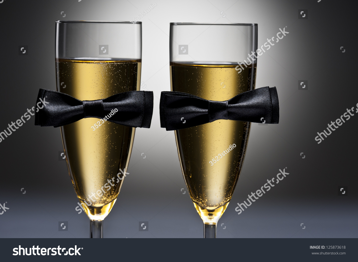 decorate champagne glasses. Champagne glasses with conceptual same sex decoration for gay men Glasses Conceptual Same Sex Decoration Stock Photo