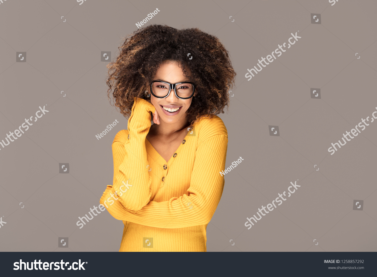 757041226031 Young beautiful african american girl with an afro hairstyle. Laughing girl  wearing eyeglasses. Portrait