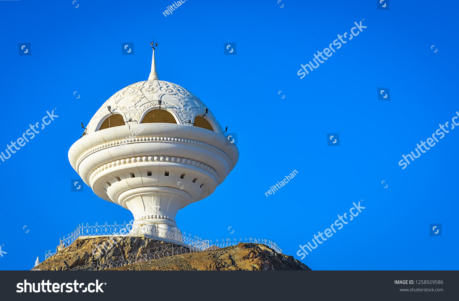 Giant frankincense burner monument in Riyam Park, Muscat, Oman with a clear blue sky as background.