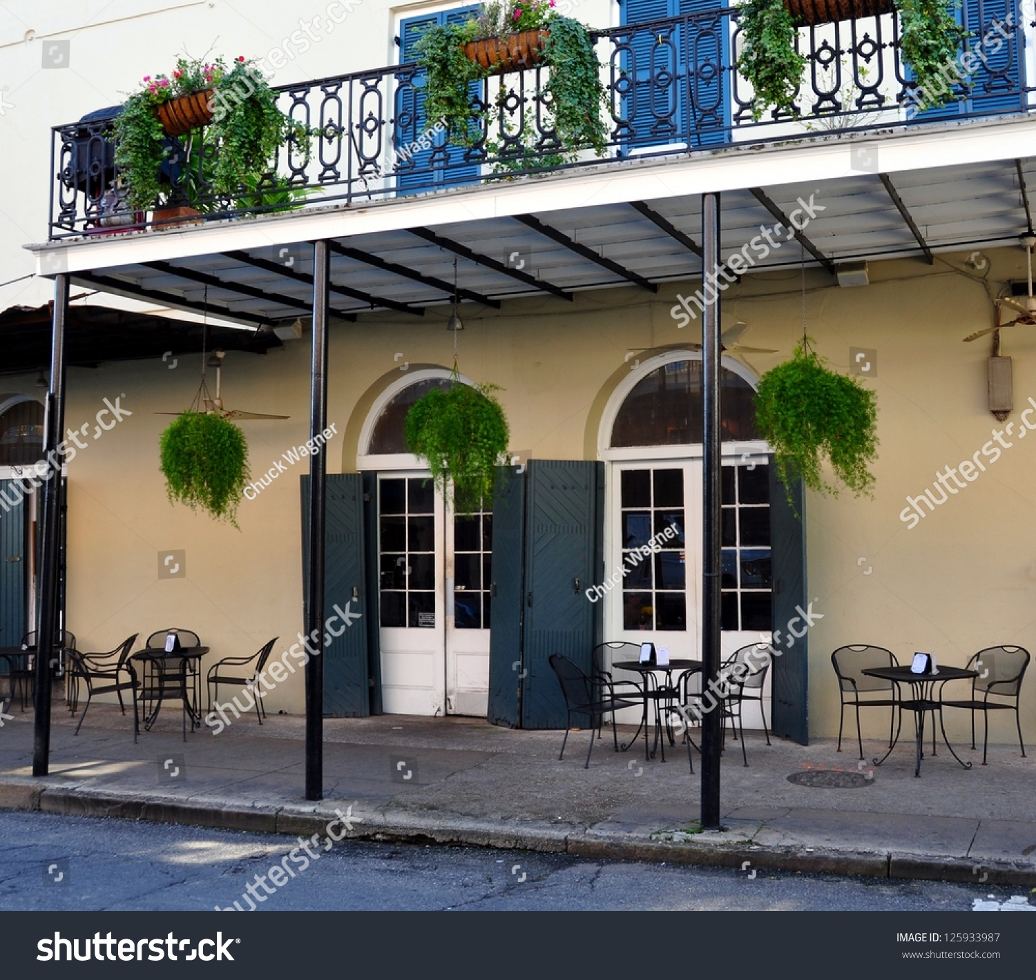 Sidewalk cafe balcony new orleans french stock photo for The balcony cafe
