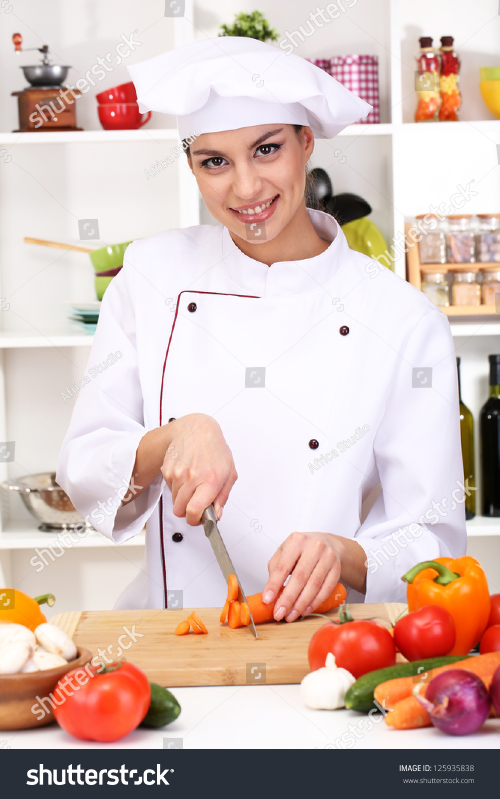 stock-photo-young-woman-chef-cooking-in-kitchen-125935838.jpg