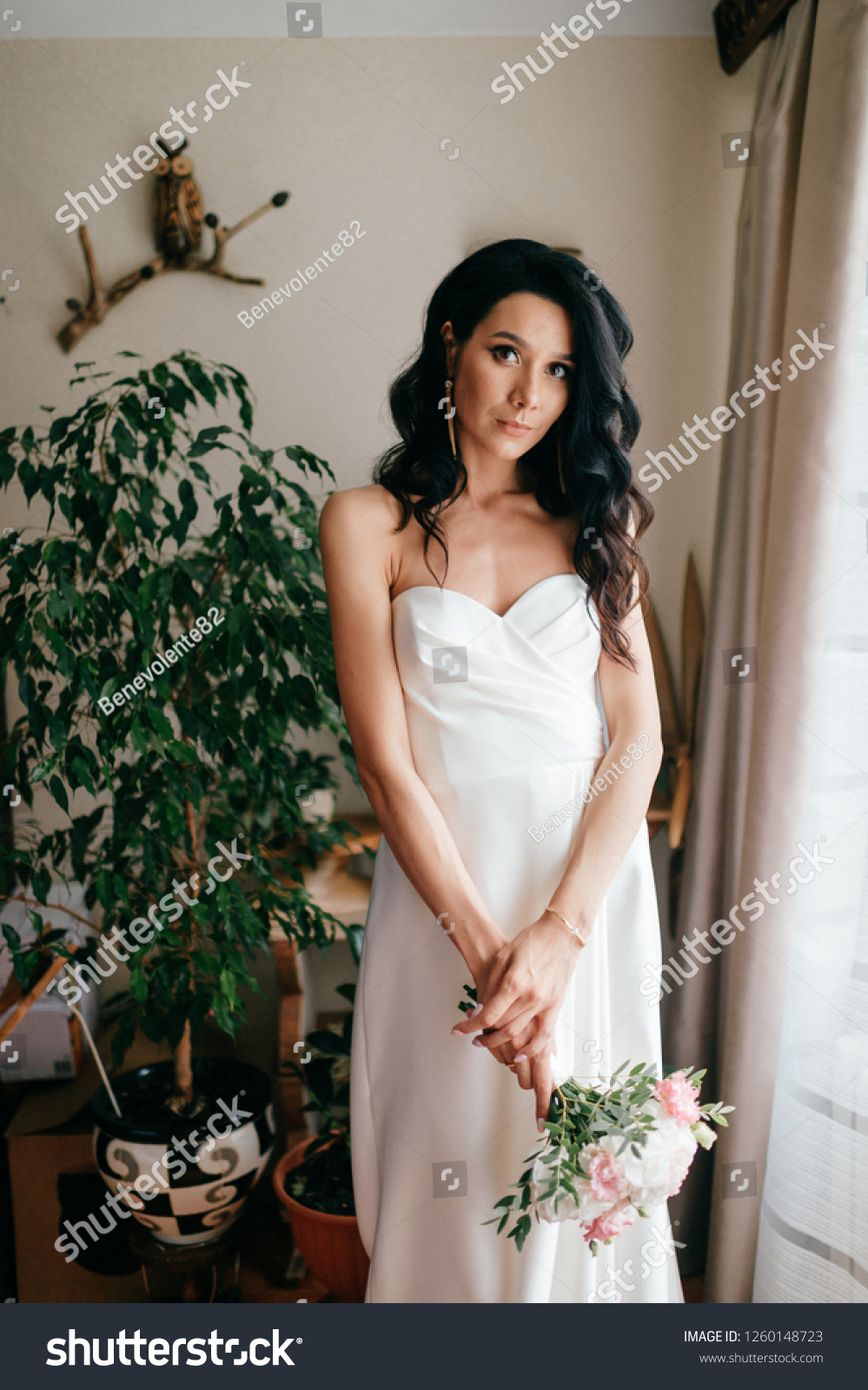 https://image.shutterstock.com/z/stock-photo-pretty-young-caucasian-bride-with-bouquet-of-flowers-posing-indoor-lovely-girl-with-spanish-1260148723.jpg