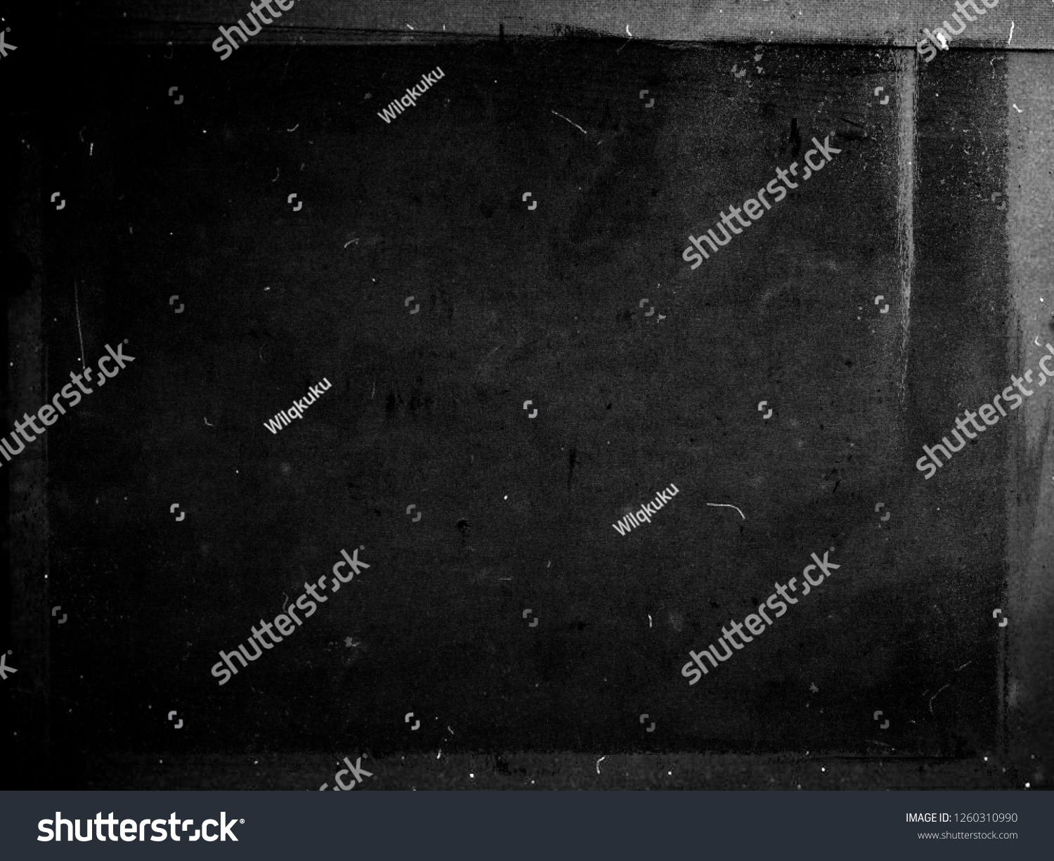 Black grunge scratched scary background with frame, distressed chalkboard, old film effect, copy space #1260310990