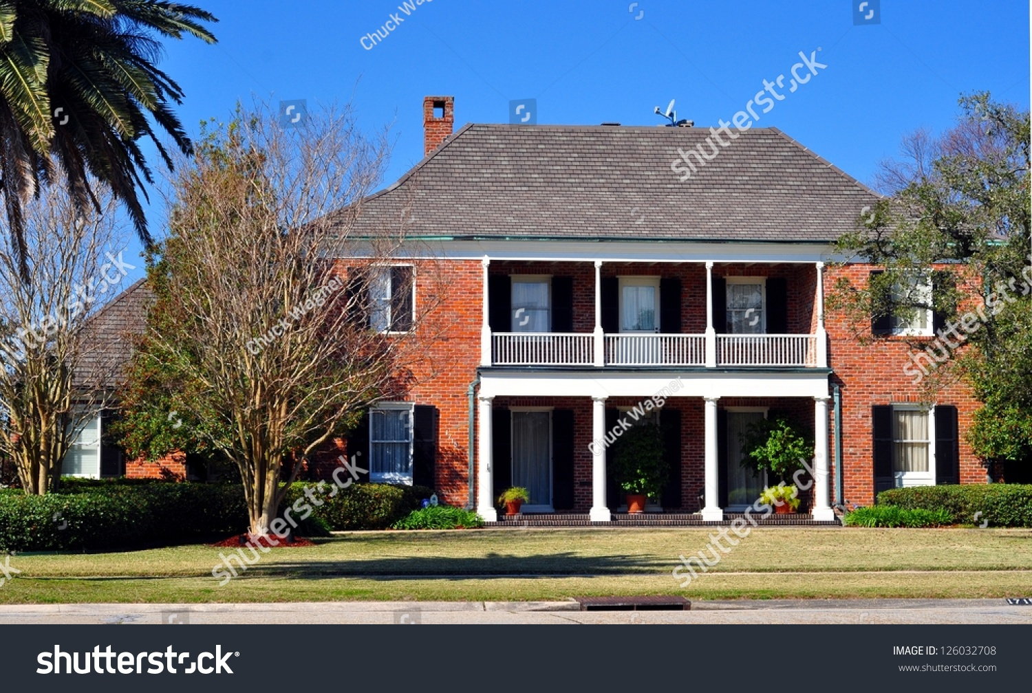 Beautiful two story brick house balcony stock photo for Beautiful two story homes