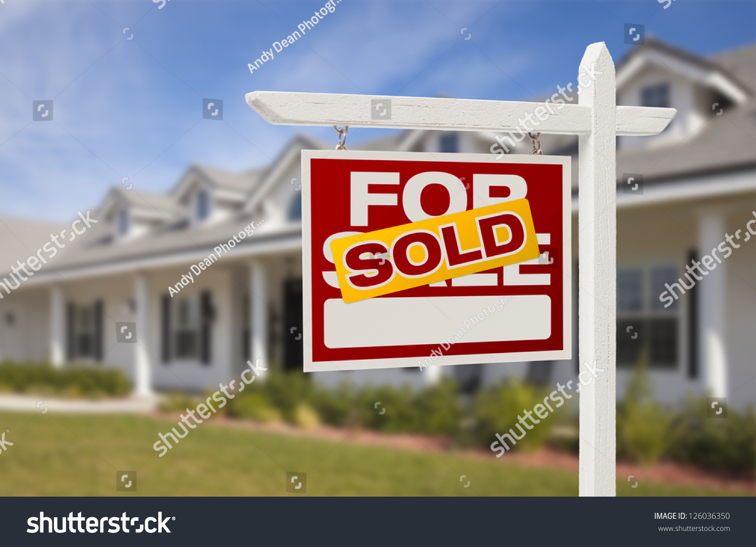 For Sale Sold Sign: For Sale Sold Real Estate Sign And New House. Stock Photo