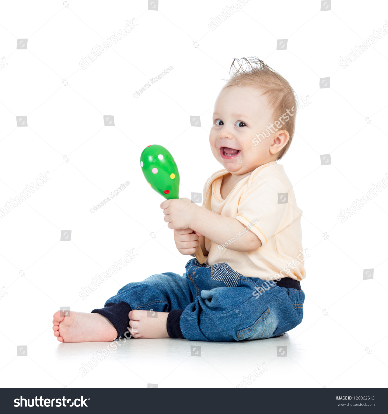Boy Toys Background : Baby boy with musical toys isolated on white background