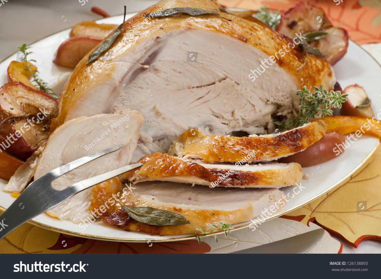 Sage - honey butter rub turkey breast garnished with roasted pumpkin ...