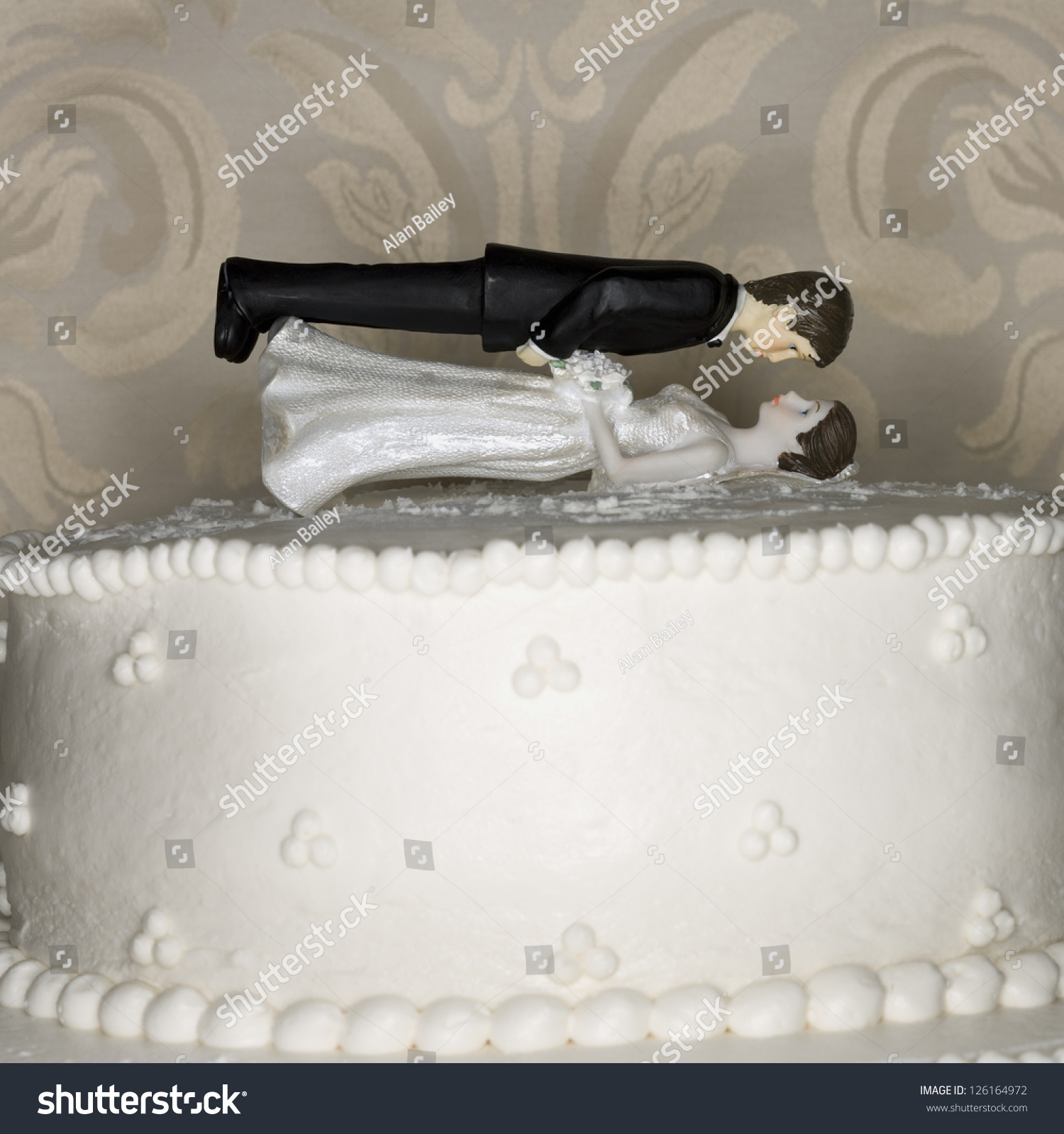 Bride Figures On Top Wedding Cake Stock Photo (Download Now ...