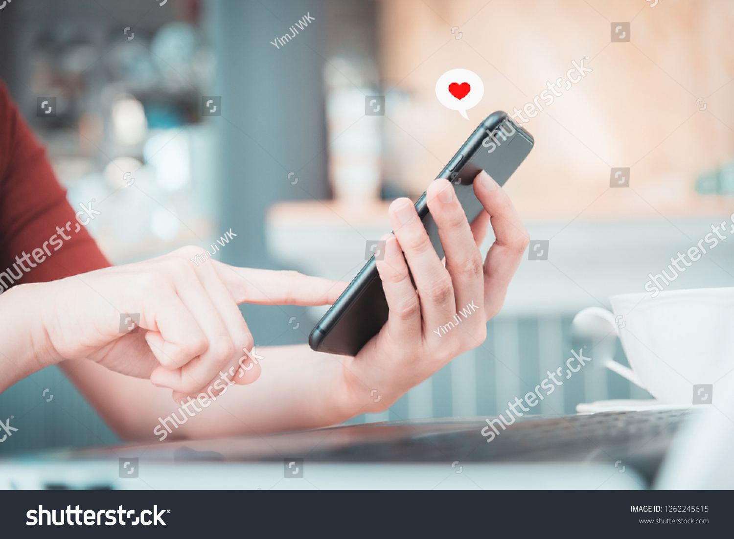 Close up hand take smart phone look  message from lovers. Send a message encouraging. #1262245615