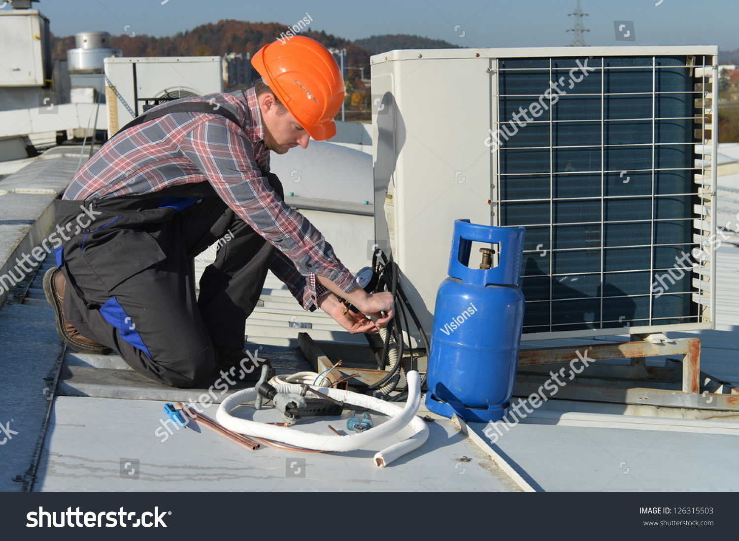 Air Conditioning Repair Young Repairman On The Roof Fixing Air Conditioning System Model Is