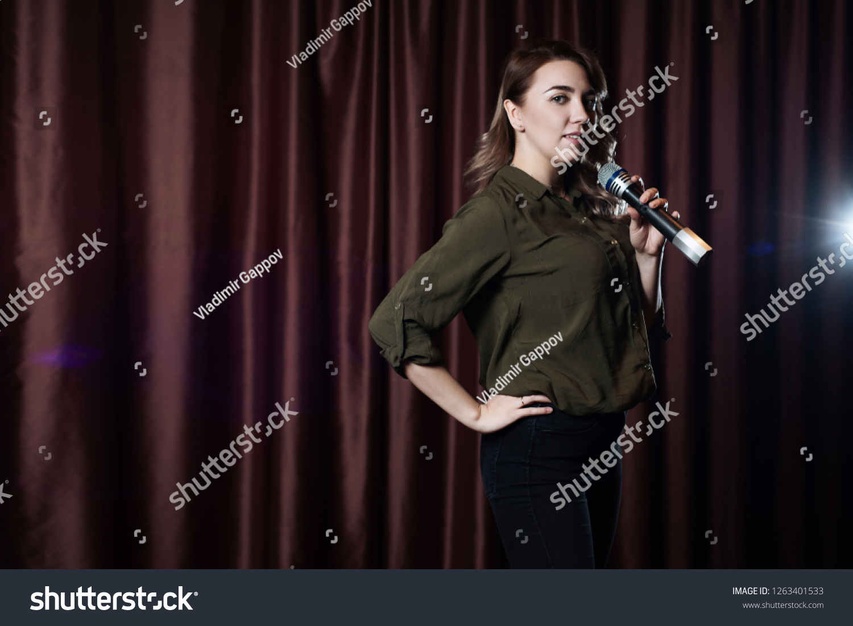 Woman Singing On Stage Microphone Karaoke Stock Photo (Edit