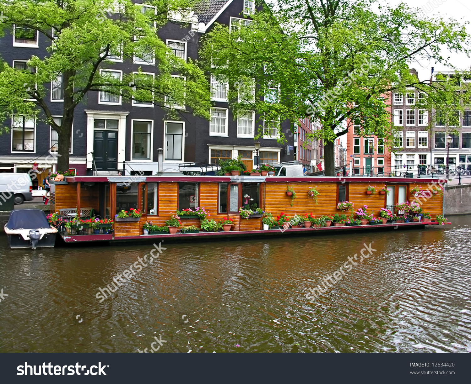 One Of Canal In Amsterdam, House On The Water