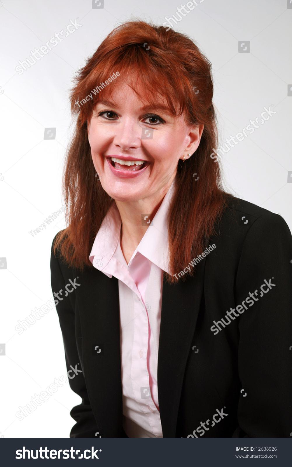 beautiful mature redhead business woman laughing stock photo