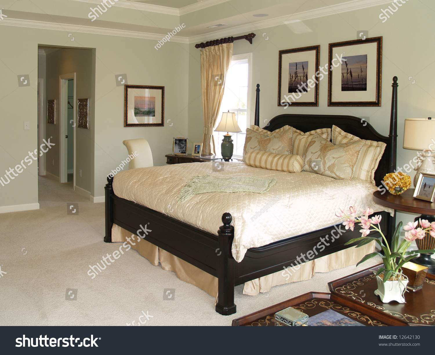 Luxury master bedroom suite in an upscale american home showing the king  sized bed and the. Luxury Master Bedroom Suite Upscale American Stock Photo 12642130