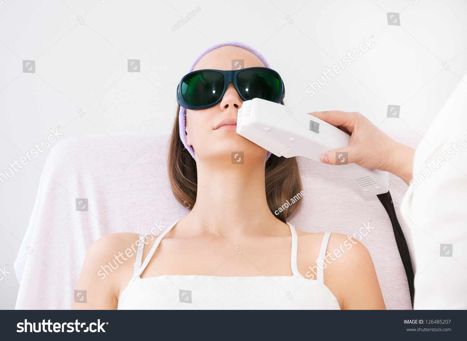 young woman receiving laser epilation on stock photo 126485207 shutterstock. Black Bedroom Furniture Sets. Home Design Ideas