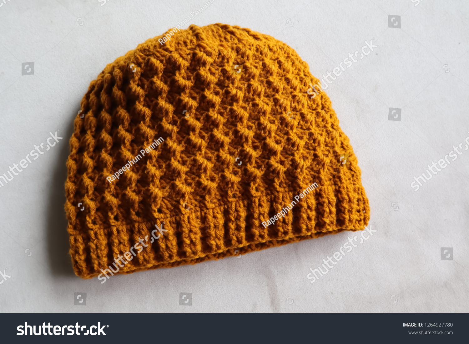 2adf4eb0 Crochet Hat On White Wood Background Stock Photo (Edit Now ...