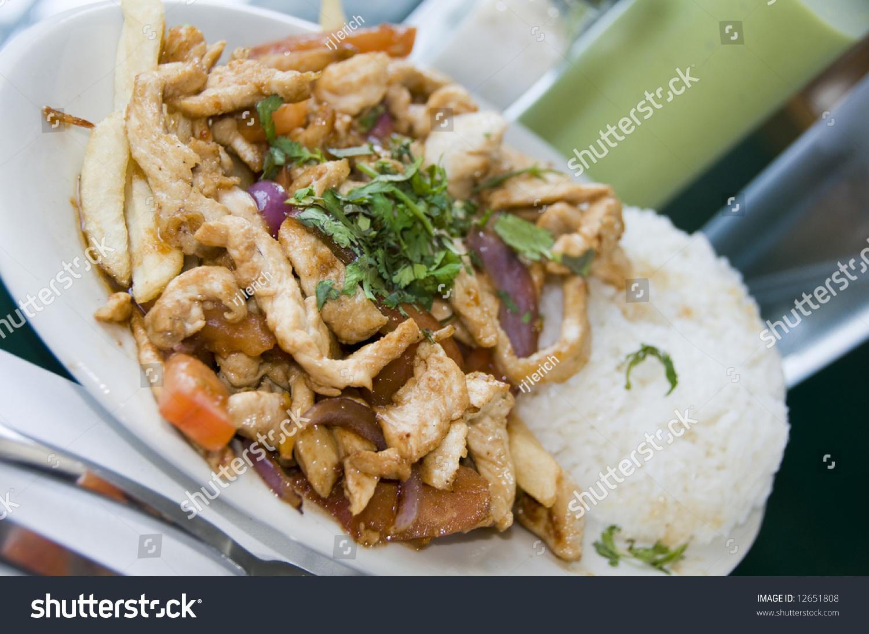 Pollo chicken strips saltado authentic peruvian food dish for Authentic peruvian cuisine