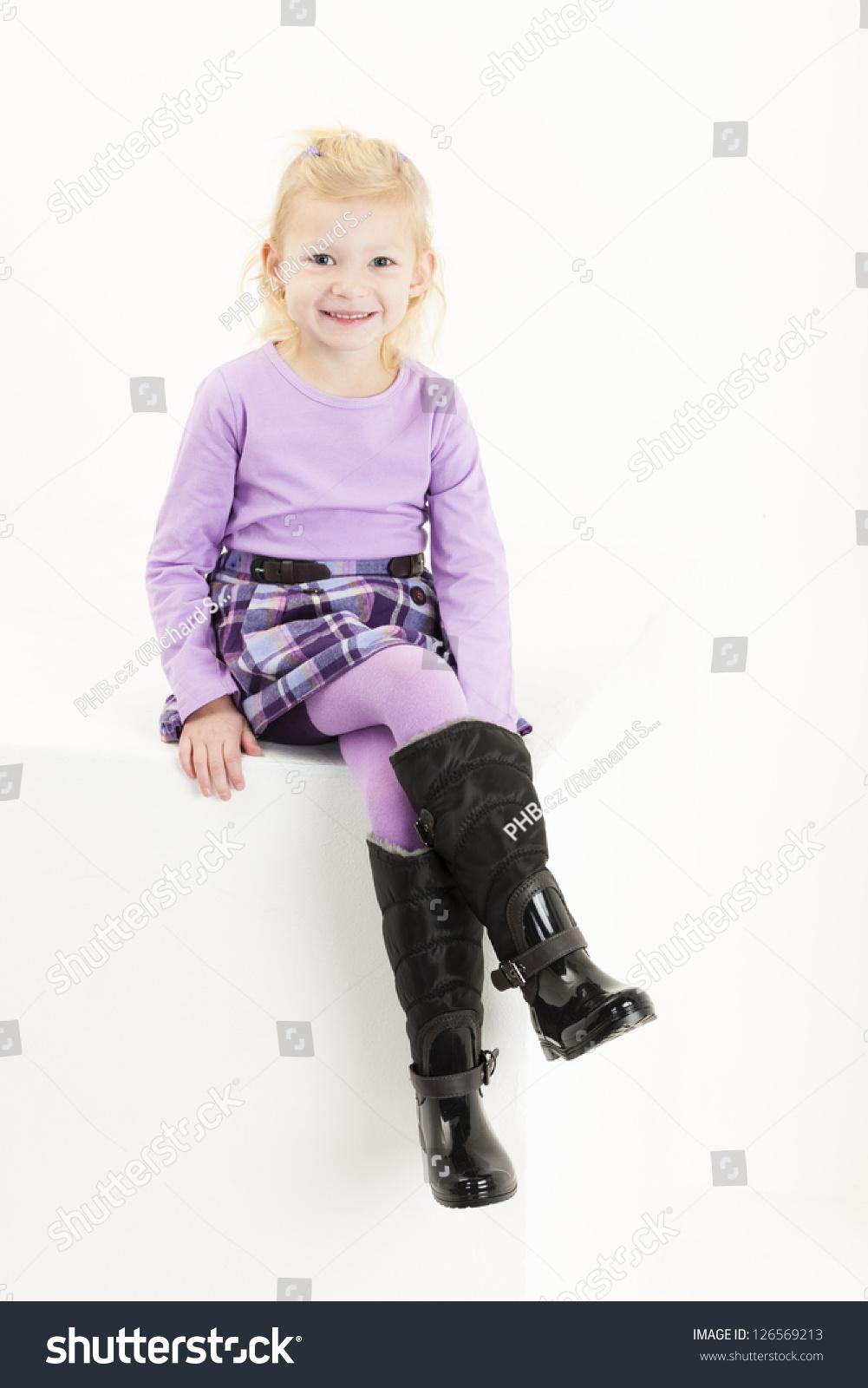 sitting little girl wearing a skirt stock photo 126569213