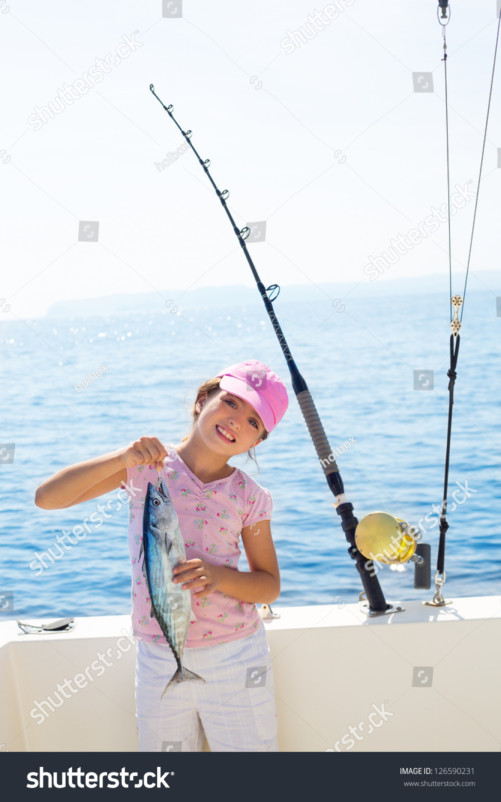 Child little girl fishing in boat holding little tunny for Little girl fishing pole