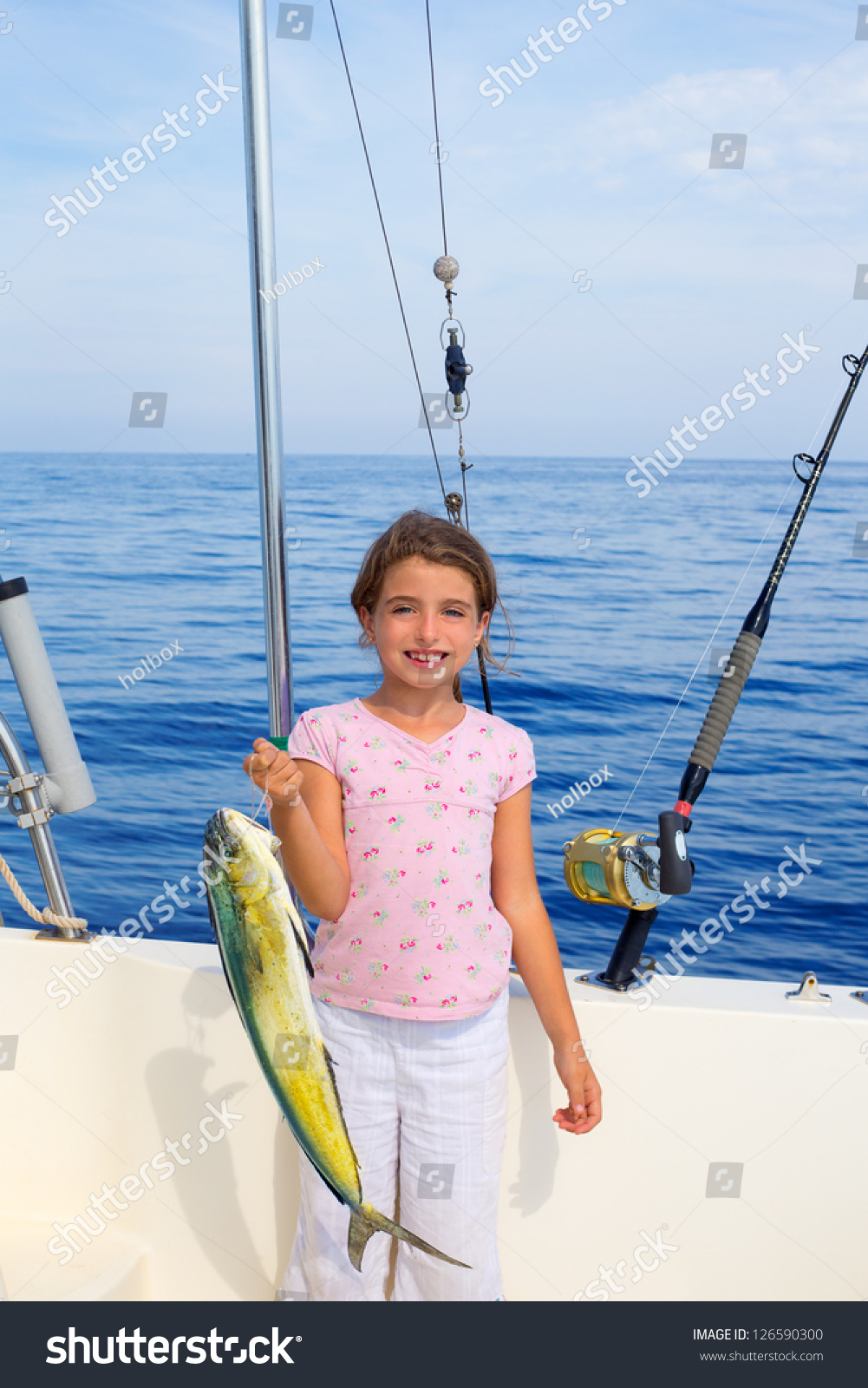 Child girl fishing boat mahi mahi stock photo 126590300 for Little girl fishing pole