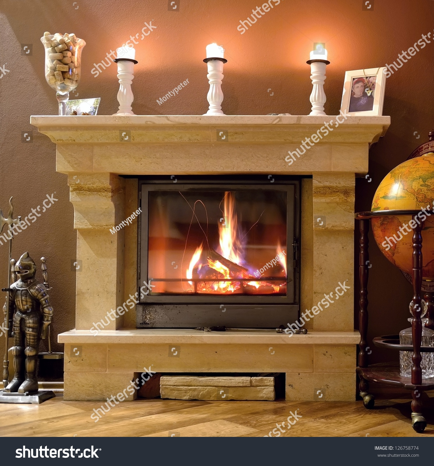 Photo interior of a home with a burning fireplace candles - Home interiors and gifts candles ...
