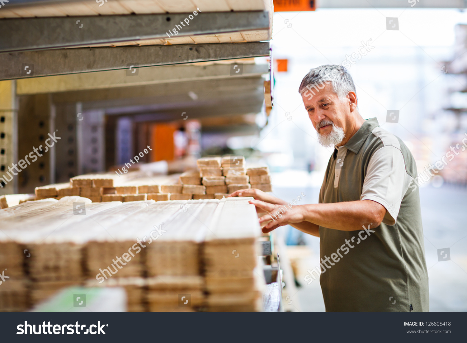 man buying construction wood in a diy store stock photo. Black Bedroom Furniture Sets. Home Design Ideas