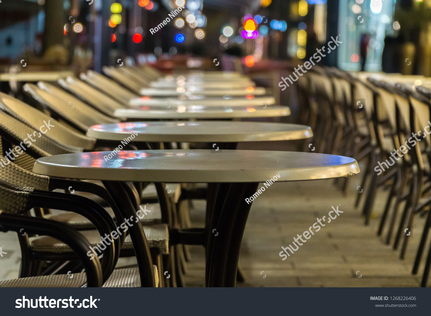 Tables and chairs in row