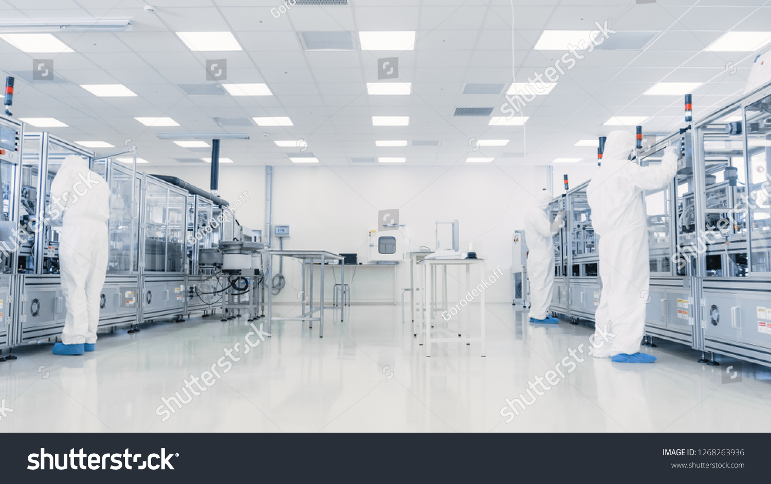 Team of Research Scientists in Sterile Suits Working with Computers, Microscopes and Modern Industrial Machinery in the Laboratory. Product Manufacturing Process: Pharmaceutics, Semiconductors #1268263936