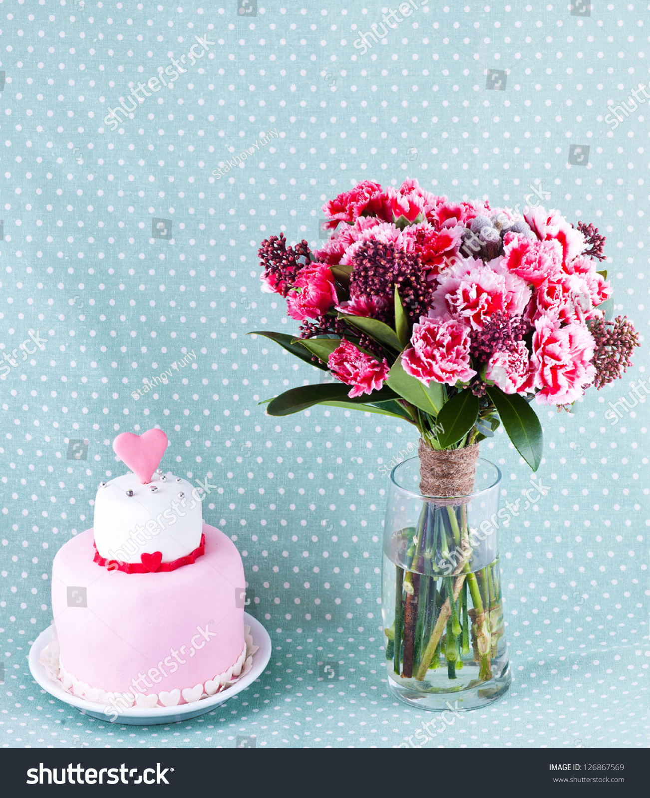 Bouquet flowers cake red hearts stock photo royalty free 126867569 bouquet of flowers and cake with red hearts izmirmasajfo