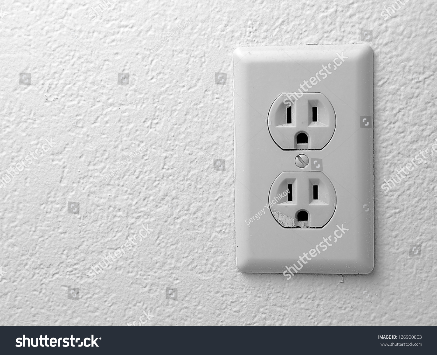 Electric Outlet On Wall Covered Wallpaper Stock Photo