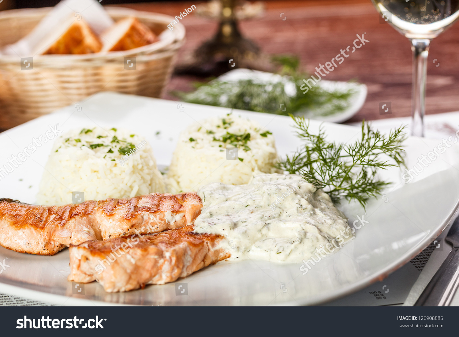 Roasted Salmon With Dill Sauce Served On Restaurant Stock ...