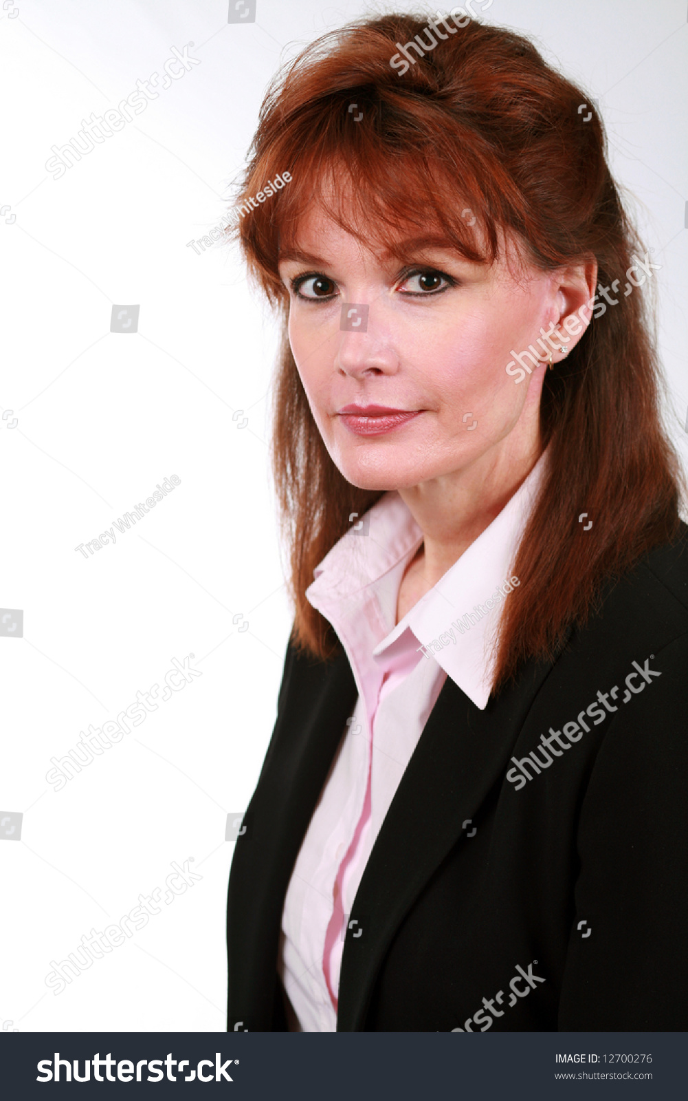 beautiful mature business woman red hair stock photo (100% legal