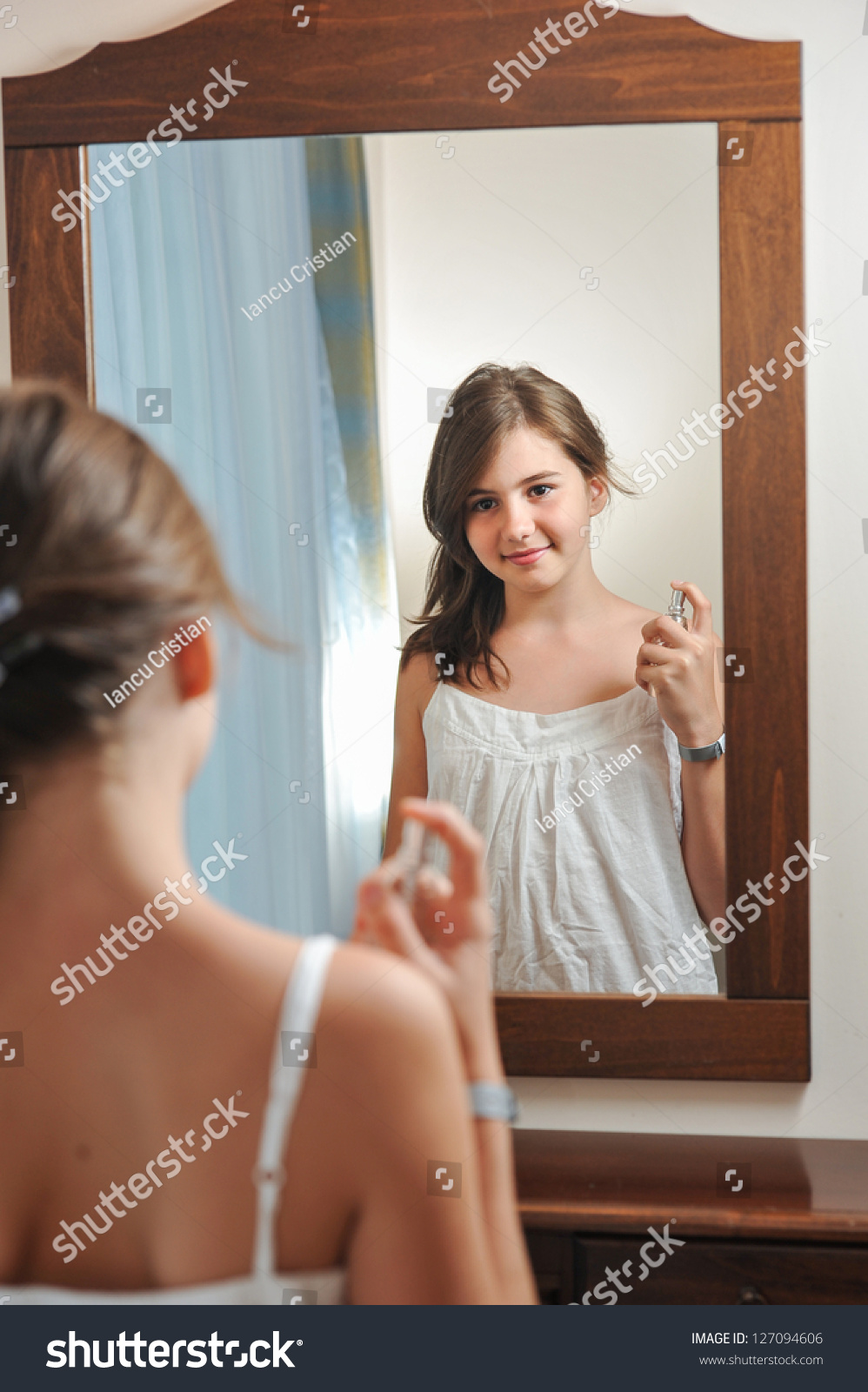 Beautiful Teen Girl Studies Her Appearance Stock Photo