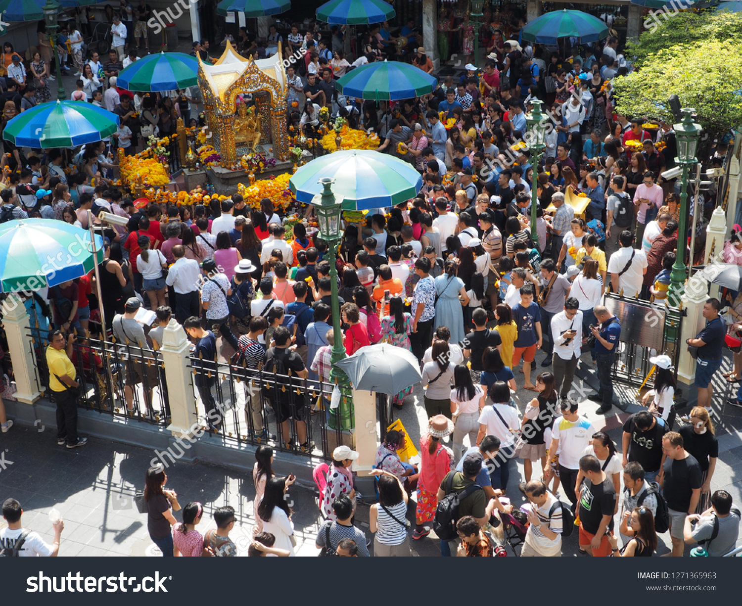 BANGKOK, THAILAND - JANUARY 1, 2019: Foreigners and local people visit and worship the Erawan Shrine at the Ratchaprasong intersection on Ratchadamri Road on January 1, 2019 in Bangkok, Thailand.