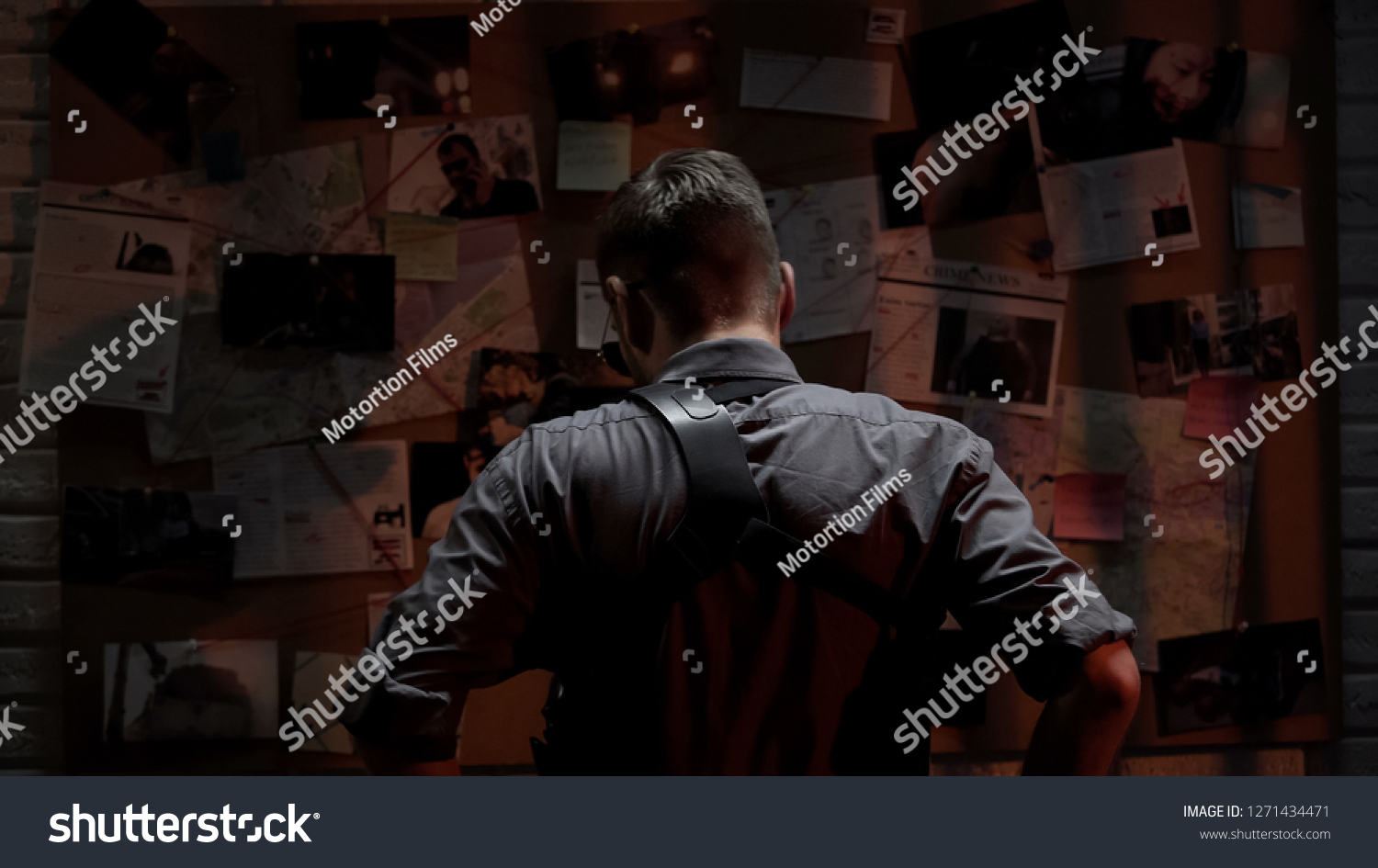 Detective looking at investigation board, searching for solution, back view #1271434471