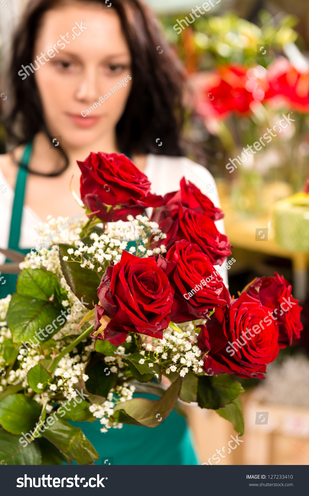 Young woman making flower bouquet florist shop roses selling ez canvas id 127233410 izmirmasajfo
