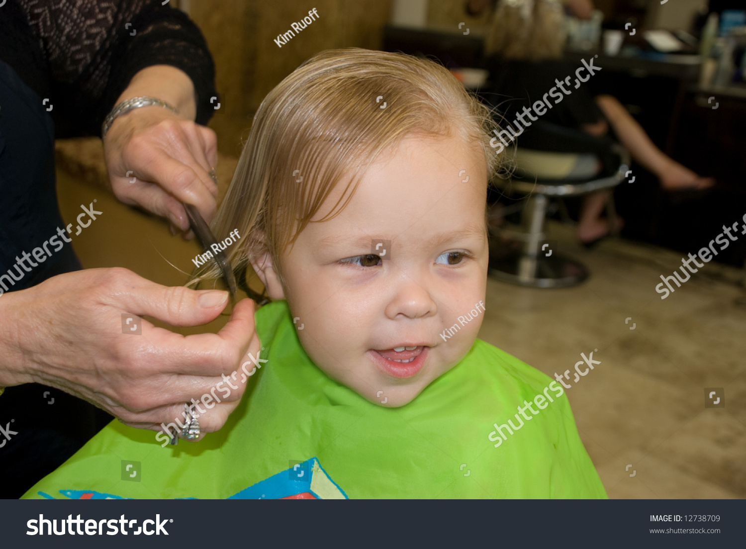 Little Girl Getting Haircut Stock Photo Download Now 12738709