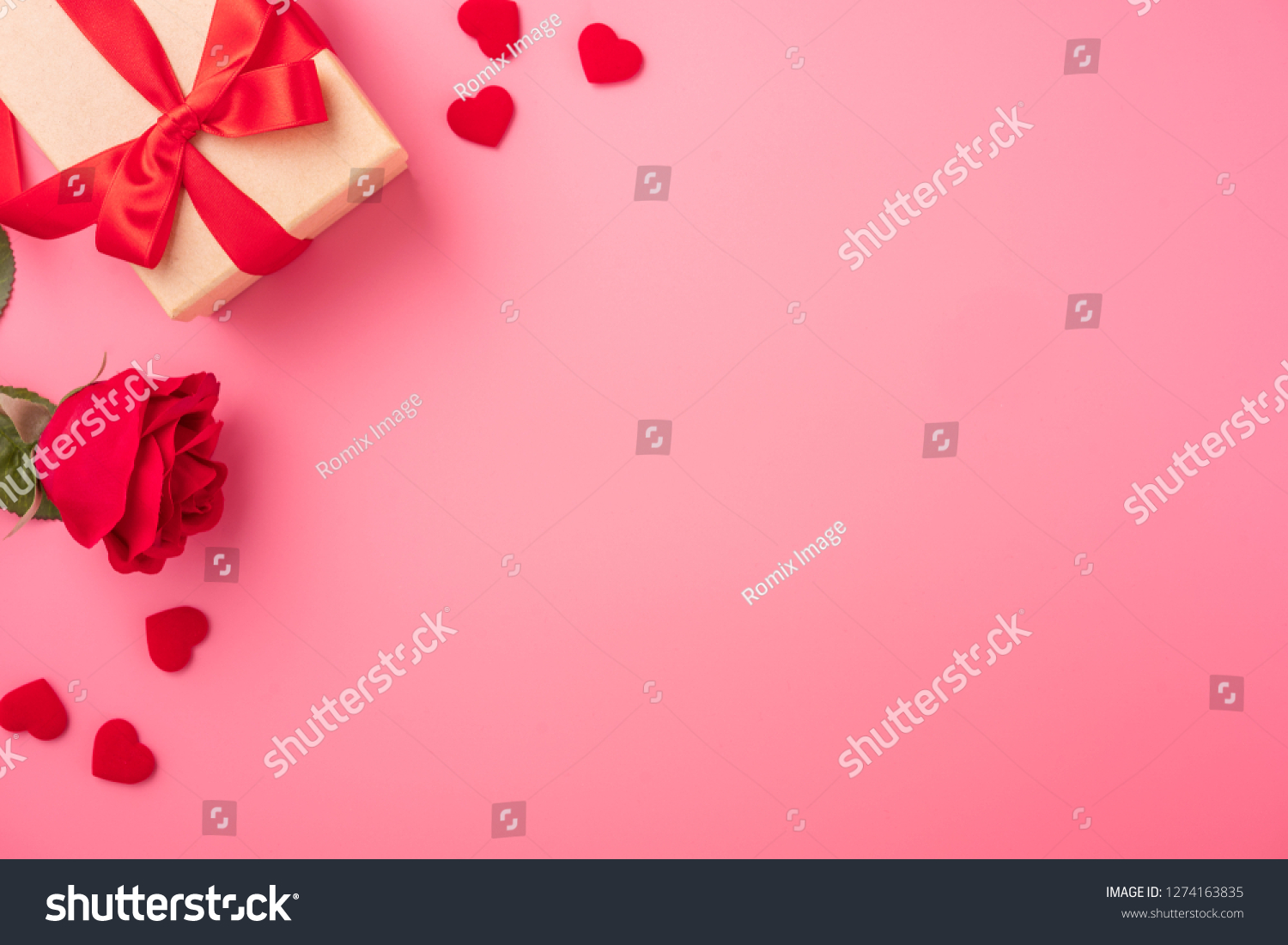 Kraft Gift box with beautiful red ribbon and rose, concept of Valentine's, anniversary, mother's day and birthday greeting, copyspace, topview. #1274163835