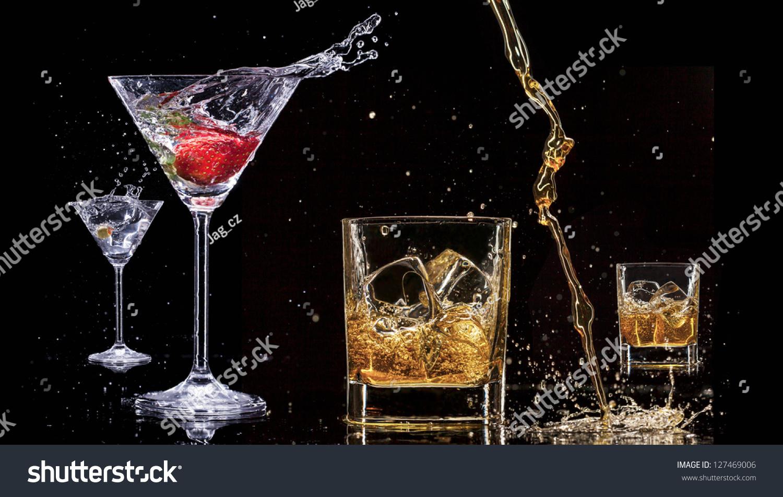 alcohol drinks splashes isolated on black stock photo