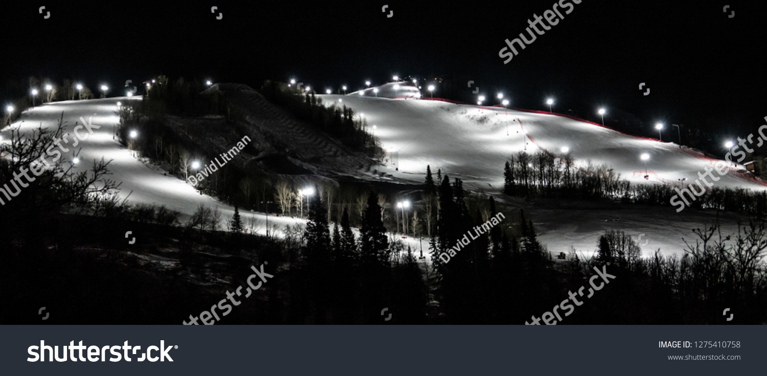 The ski slopes at Steamboat Springs, in the Rocky Mountains of Colorado, are lined by lights to allow for night skiing and snow boarding.