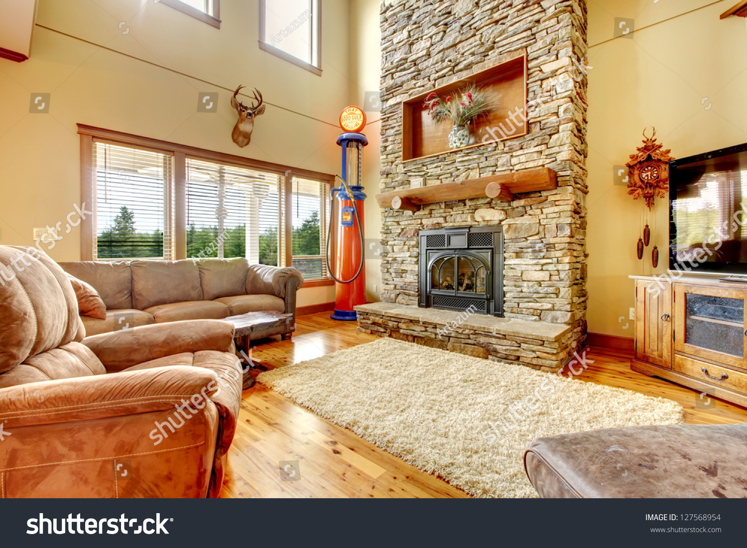 living room high ceiling stone fireplace stock photo 127568954
