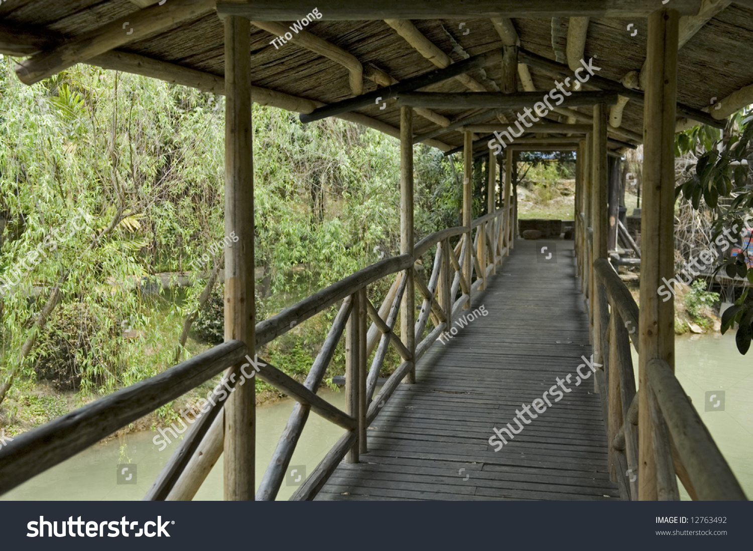 Over The Garden Walk: The Corridor Of Wooden Walk Bridge Over Lake In Garden