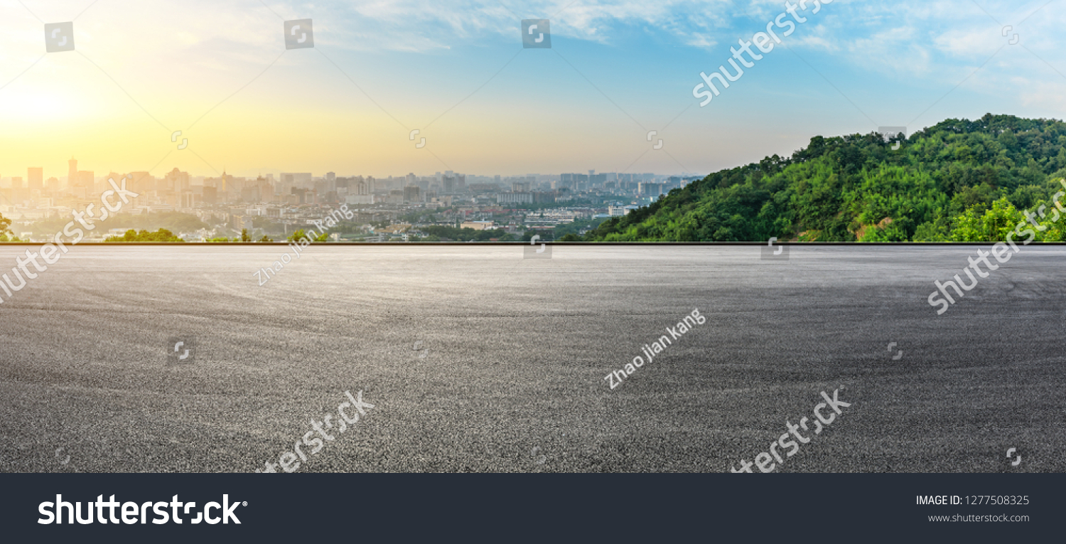 Panoramic city skyline and buildings with empty asphalt road at sunrise #1277508325