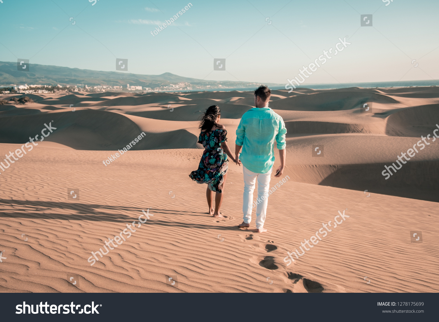couple walking at the beach of Maspalomas Gran Canaria Spain, men and woman at the sand dunes desert of Maspalomas #1278175699