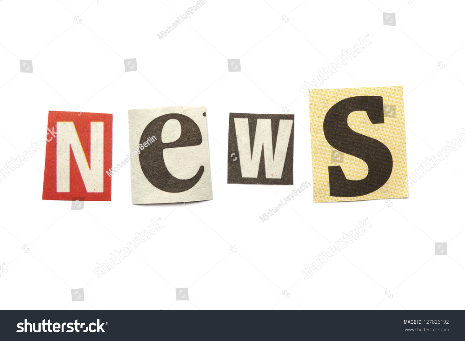 set of letters cut out from newspaper in blackmail style saying news