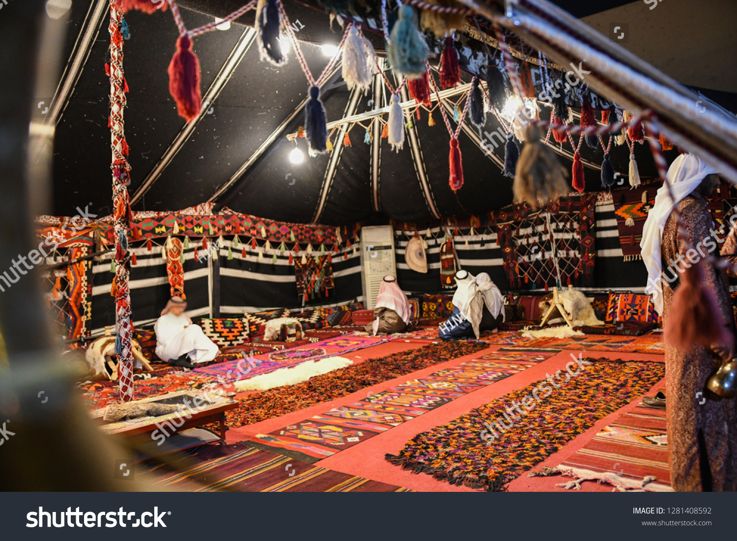 The traditional Bedouin Tent in Saudi Arabia with Arabian people wear traditional clothes